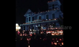 Thousands of pumpkins light up West Virginia house