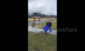 Girl takes spectacular fall in muddy puddle