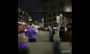 Eccentric man with megaphone shouts at jay-walkers in London