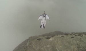 Wingsuit BASE Jumper Lands Through Roof