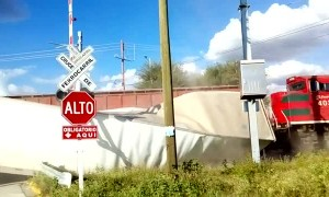 Truck Crosses Train Track at the Worst Possible Time