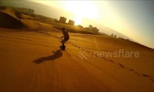 Daredevils go sandboarding across giant dunes in Chile