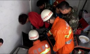 Chinese firefighters free man with arm trapped in noodle-making machine