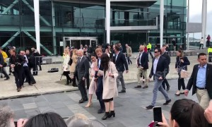 Pregnant Meghan Markle clutches belly as royal couple meets public in downtown Auckland