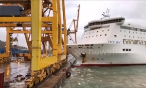 Fire breaks out in Barcelona harbour after ferry crashes into crane
