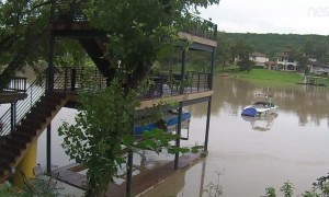 Man Swims After Boat During Austin Flood