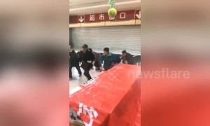 Chinese seniors race through supermarket to grab groceries