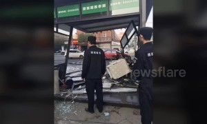 Out-of-control car ploughs into security booth injuring two