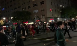 Costumed dancers move to the tune of 'Thriller' at NYC Village Halloween Parade