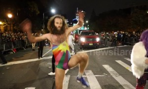 Man in woman's bathing suit performs striptease dance at NYC Halloween parade