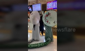 Half-snake, half-human Halloween costume scares shoppers at Beijing mall