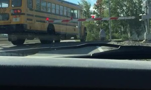 School Bus Crosses Closed Train Tracks