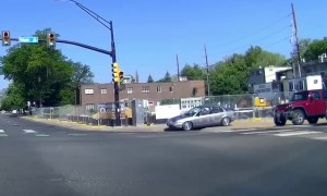 Car drives along sidewalk at intersection