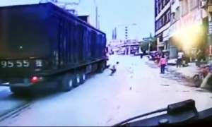 Scooter driver narrowly escapes being run over by lorry