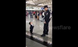 Cute boy just wants a hug from airport security guard