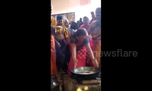 Hindu devotees engage in fiery rite by dipping hands in boiling oil to fulfil vow