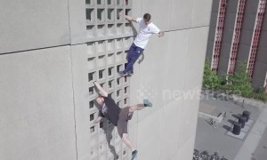 Daredevil climbers easily scale 10-floor apartment block in Denmark