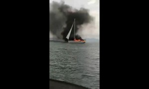 Nine British tourists rescued from burning yacht after it was struck by lightning
