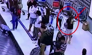 Couple steal US tourist's designer suitcases from Bangkok airport baggage carousel
