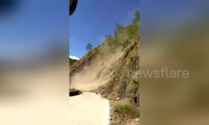 Terrifying moment bus passengers scream after getting stuck yards from landslide