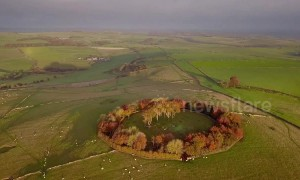 Dawn breaks over ring of autumnal trees in the Peak District in breathtaking drone footage