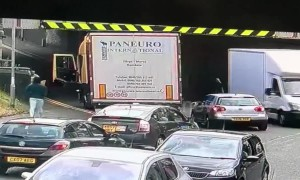 Hapless truck driver gets stuck under low bridge in UK's Rochdale