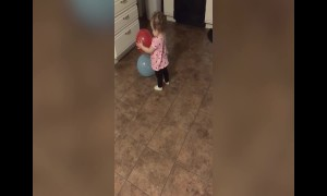 Baby Girl Learns about Balloons