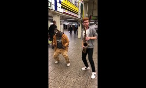 Sax player in NYC subway plays Bruno Mars tune as homeless man dances