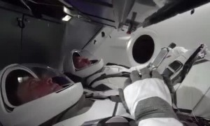 NASA astronauts in new space suits train in SpaceX capsule