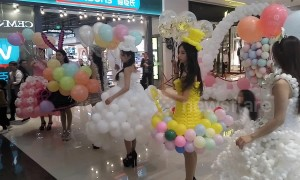 Models demonstrate unique balloon dresses at Chinese mall