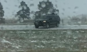 Driver Fishtails on I-80 in Snowy Conditions