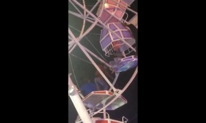 Ferris wheel gondolas flip upside down with families inside