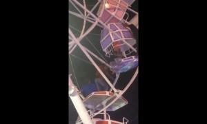 Ferris wheel gondolas flip upside down with families inside