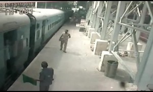 Hero cop saves woman from slipping under moving train