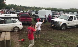 Subaru Impreza Pulls Ford F-350 From the Mud