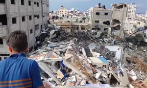 Palestinians inspect ruins of Hamas TV station after Israeli air strike on Gaza