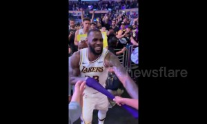 Young fan freaks out when LeBron hands his arm sleeve to him