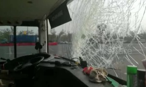 Dashcam shows bus windscreen getting smashed by flying piece of wood