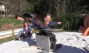 Australian science teacher gives daughter her first iFly experience using wakeboard and bouncy castle fan