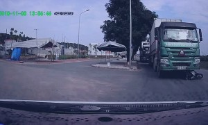 Man Crashes Motorcycle and Narrowly Escapes Moving Truck