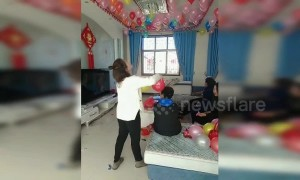 Wedding prepper makes balloons stick in place by rubbing them on her brother's head