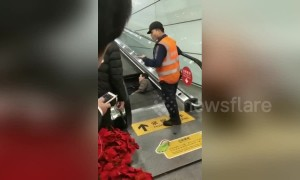 Airport crews rescue man trapped neck-deep in escalator
