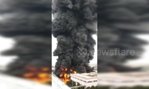 Pillar of black smoke spews from huge fire at Chinese industrial park