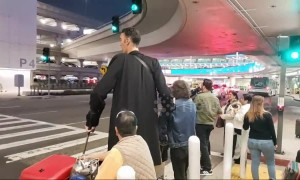 World's tallest man arrives at LAX