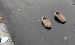 Girl's Shoes Stuck to Racetrack