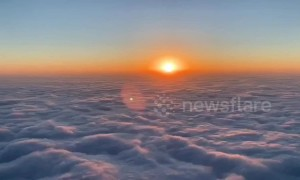 Gorgeous time-lapse shows sunrise over clouds roiling like waves