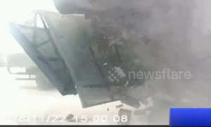 Passerby runs away seconds before warehouse collapses in dramatic crash