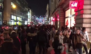 Crowds of late-night Black Friday shoppers swarm Oxford Street