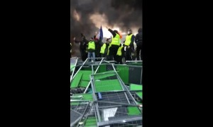 Fuel tax protesters light fire on Champs-Elysées in Paris