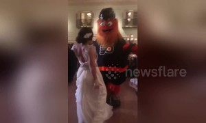 Philadelphia Flyers mascot Gritty crashes fans' wedding